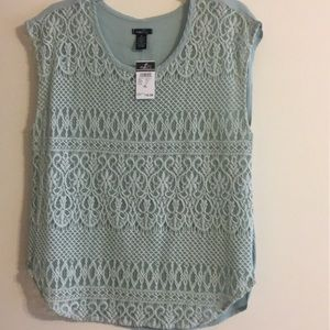 NWT mint in color sleeveless blouse.